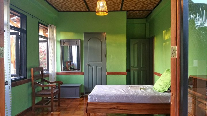 The green color walls in one of the bedrooms second floor
